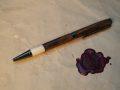 bocote pen, with deer antler tip, side view